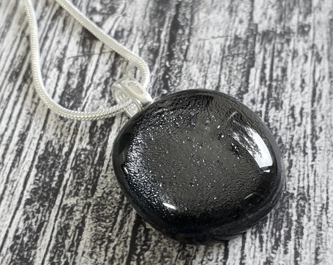 Dichroic glass pendant in dark grey and silver.