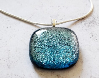 Dichroic glass pendant in pale blue and silver.