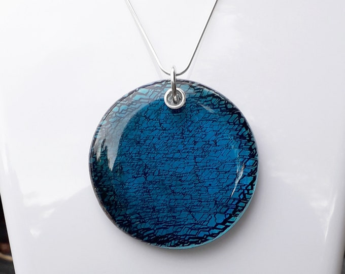 Fused glass pendant, turquoise blue and black pattern, set with sterling silver
