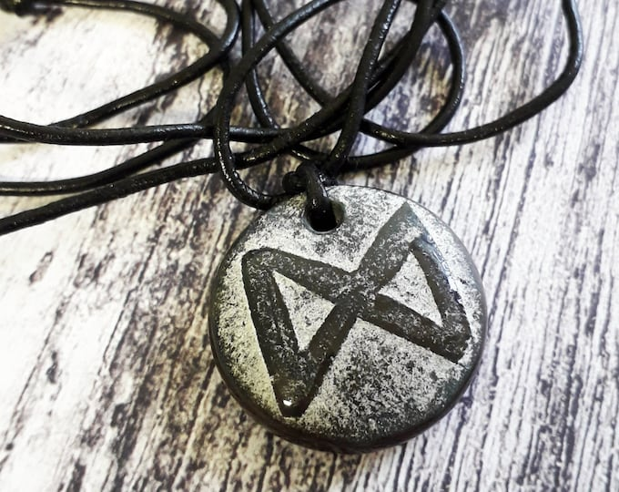 Rune pendant, black cast glass and leather, Dagaz.