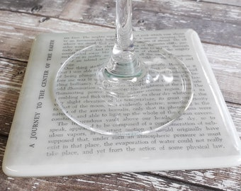 Coaster with Journey to the Centre of the Earth text in fused glass