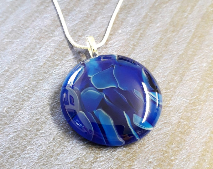Blue cast glass pendant, made from mix of light and dark blue glass.