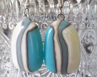 Cast glass earrings, made from seaside-themed aqua blue and cream glass, with sterling silver wires.