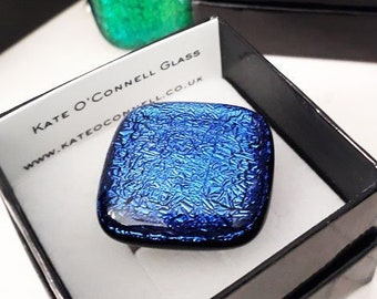 Dichroic glass ring, made from blue and black fused glass on a silver band.