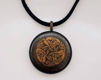 Celtic knotwork pendant, gold, bronze and black fused glass.