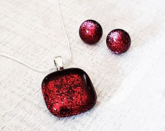 Cranberry pink jewellery set, pendant and earrings in dark pink/red and black dichroic glass with silver findings