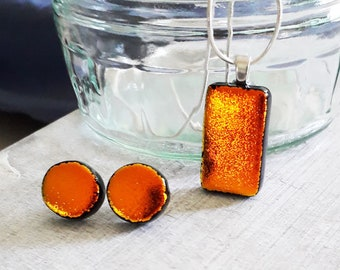 Dichroic jewellery set made with red/gold/black dichroic glass set on sterling silver.