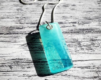 Fused glass pendant, pale blue glass on sterling silver