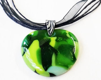 Green heart pendant, cast glass in a mix of pale, dark & sparkly greens