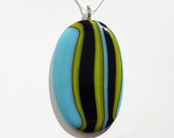 Big glass pendant, made from stripey blue, black and green fused glass.