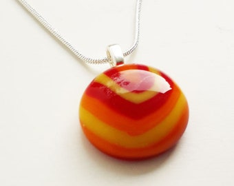 Fused glass pendant, in red, yellow and orange glass. A teeny tiny one!