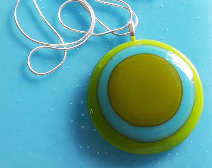 Fused glass pendant in cool green & blue colours.