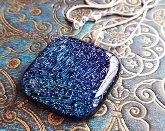 Dichroic glass pendant in blue/aqua/purple fused glass.