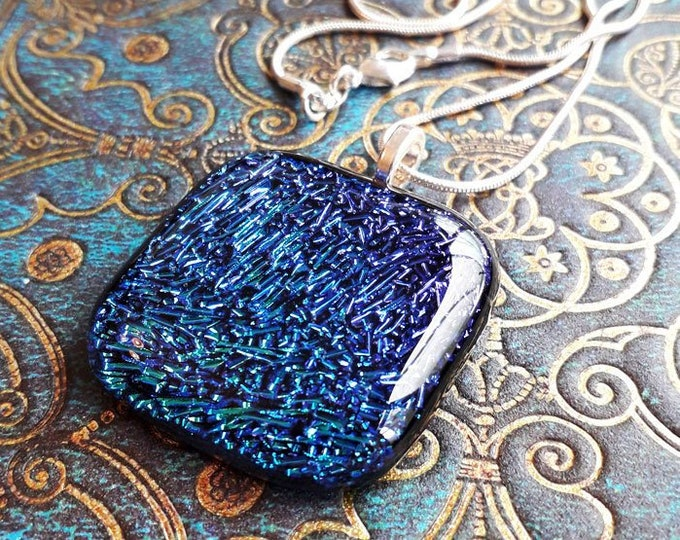 Dichroic glass pendant in blue/aqua/purple fused glass.