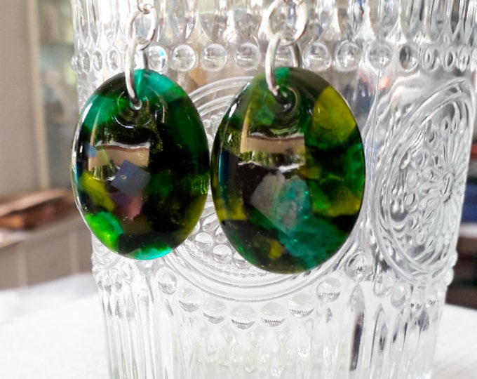 Cast glass earrings in various greens, iridescent and dichroic glass, with sterling silver.
