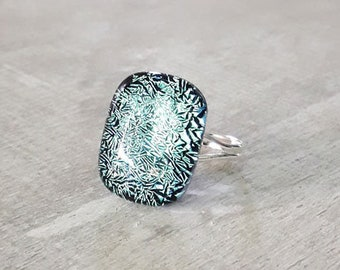Fused glass ring, in pale blue, silver and black glass on a silver band.