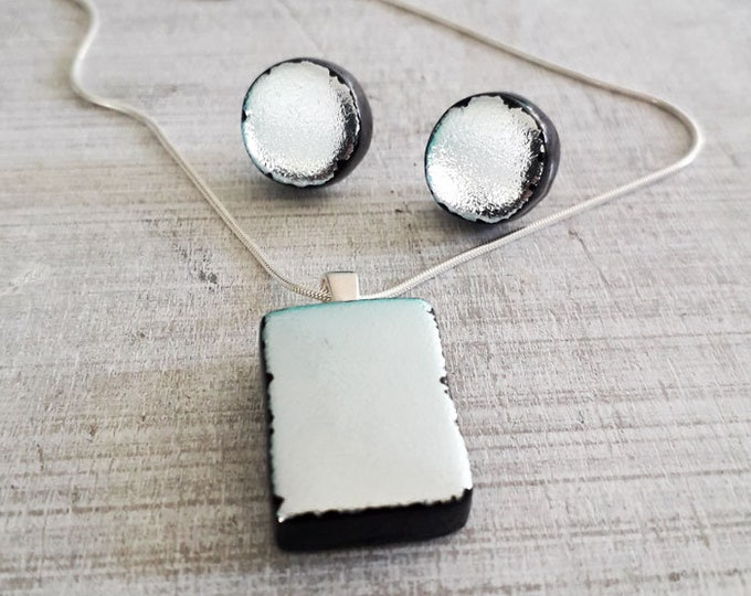Dichroic jewellery set made with silver and black dichroic glass set on sterling silver.