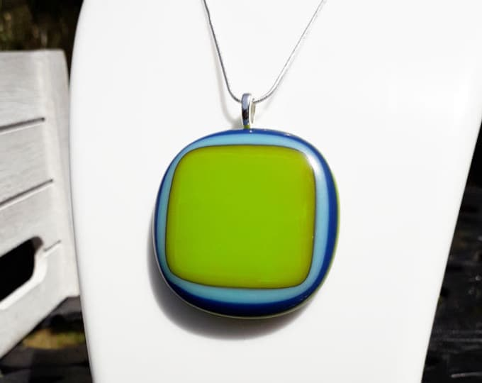 Fused glass pendant, green and blue fused glass on silver.