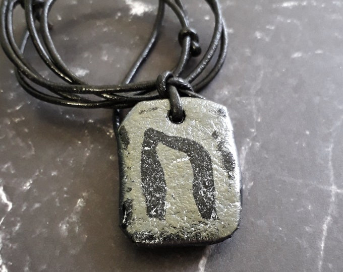 Rune pendant, black cast glass and leather, Uruz.