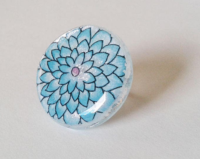 Aqua floral ring, silver dichroic glass with aqua and pink floral design.