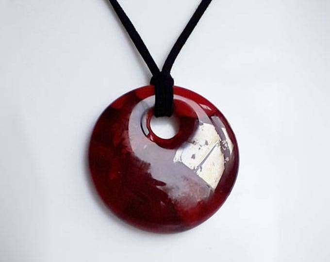 Red glass pendant, cast glass in unique mix of reds and iridescent colours.