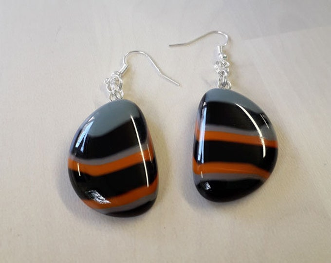 Fused glass earrings, made from orange, black and grey fused glass on silver.