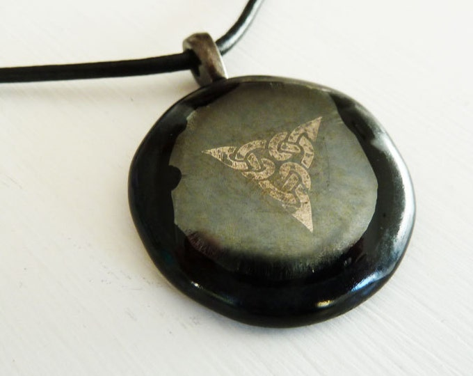 Black pewter & silver steampunk-inspired pendant with celtic knotwork.