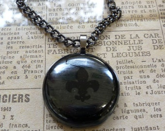 Fleur de lys pendant in black & metallic fused glass.