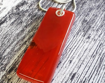 Fused glass pendant, red glass on sterling silver