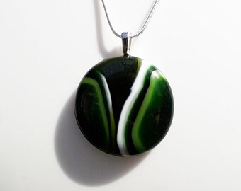 Green fused glass pendant, with green and white stripey pattern, iridescent and sparkly glass.
