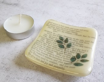 A Midsummer Night's Dream trinket dish, cream fused glass with text from the play and leaves.