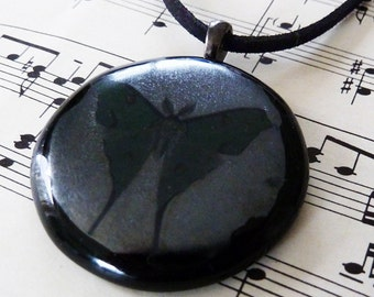 Black fused glass pendant with iridescent grey & green butterfly illustration