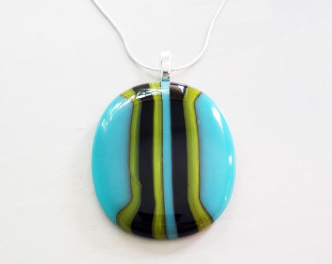 Fused glass pendant, made from stripey blue, black and green fused glass.
