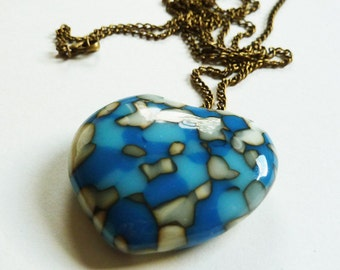 Cast glass heart pendant, blue, cream and white glass heart necklace with long bronze metal chain