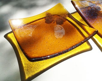 Amber glass bowl with butterfly design, fused glass