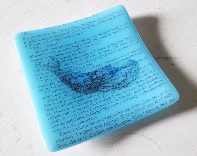 Jules Verne trinket dish, blue fused glass with text from Jules Verne's 20000 Leagues Under The Sea and whale design.