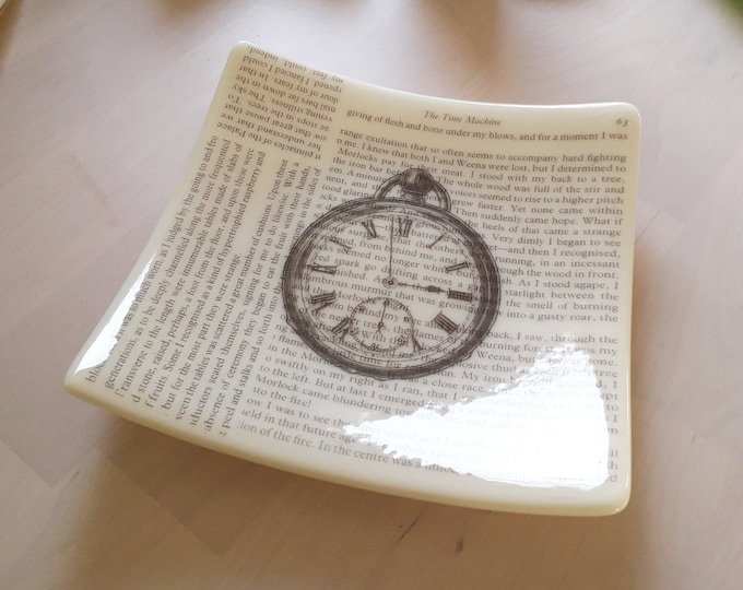 Time Machine Dish, cream fused glass with text from HG Wells' The Time Machine and vintage clock illustration