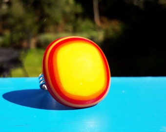 Fused glass ring, in yellow, red & orange opaque glass.