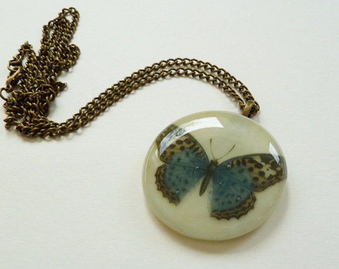 Butterfly pendant - blue vintage butterfly illustration on cream fused glass