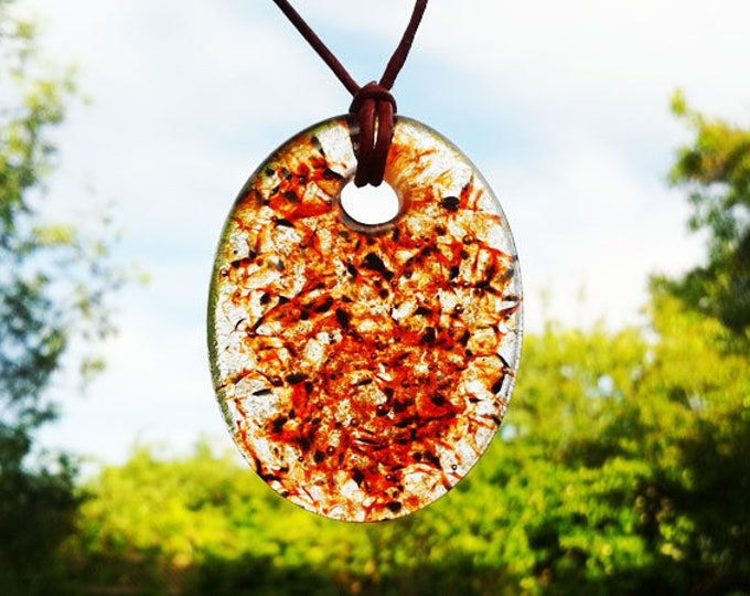 Red and black cast glass pendant with clear transparent speckle design