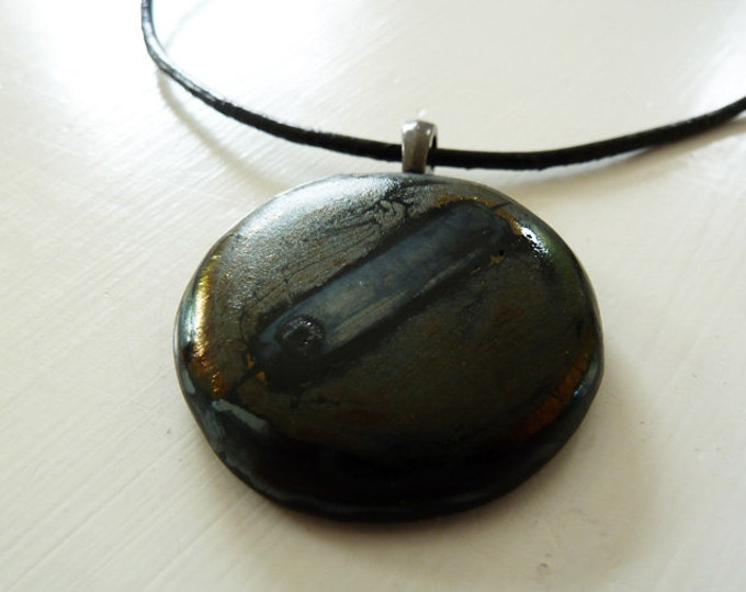 Black fused glass pendant with industrial metallic finish.