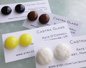 Cast glass stud earrings for pierced ears.