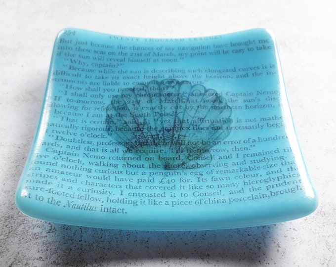 Turtle trinket dish, with text from Jules Verne's 20000 Leagues Under The Sea, on blue fused glass.