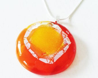 Orange, yellow & silver cast glass pendant.