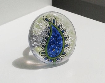 Blue paisley ring, fused silver dichroic glas with blue, green, and black paisley detail