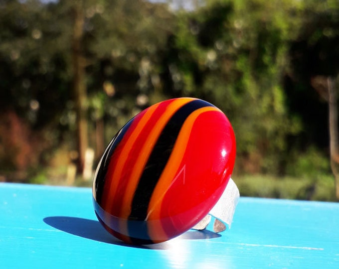 Fused glass ring, in red, orange and black stripe opaque glass.