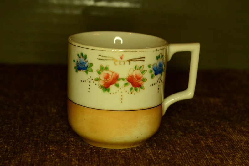 Small cup / made in occupied Japan / amber / iridescent bottom / Japan /  occupied Japan / cup / teacup / floral / iridescent