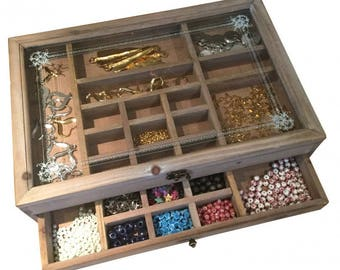 With a drawer wooden storage box. Glass on top.