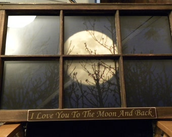 old window sash with full moon photo