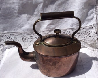 A small oval Copper Kettle from the 19th Century.